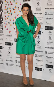 Ana wore a bright green draped cocktail dress with a tan pair of ankle booties. The intricate style kept them interesting while not taking away from her bold dress.