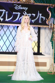 Elle Fanning totally dressed the part in an elaborate Alexander McQueen fairy-tale gown during the 'Maleficent' premiere in Tokyo.