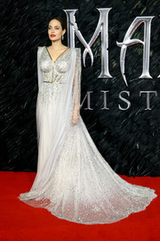 Angelina Jolie looked downright regal in a caped and beaded gown by Ralph & Russo Couture at the European premiere of 'Maleficent: Mistress of Evil.'