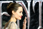Angelina Jolie kept it classic with this bun at the European premiere of 'Maleficent: Mistress of Evil.'