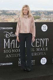 Michelle Pfeiffer paired her top with simple black trousers.