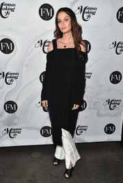 Nicole Trunfio teamed a black cold-shoulder midi dress with white trousers for the Mamas Making It Summit.
