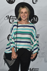 Ali Fedotowsky arrived for the Mamas Making It Summit carrying a black-and-white striped shoulder bag.