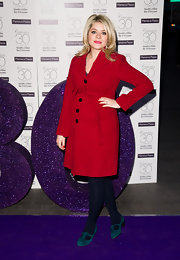 Holly Willoughby chose a bright red wool coat with a matching belt for her look at the Mamas and Papas 30th anniversary party.