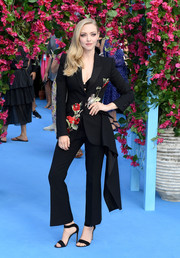 Amanda Seyfried complemented her suit with black ankle-strap sandals.