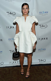 Mandy Moore pulled her look together with a black leather purse by Gabriela Hearst.