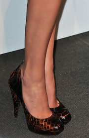 Adding some texture to Julia's look was a bronze pair of snakeskin pumps.
