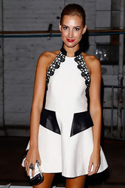 Laura Dundovic completed her black-and-white-themed ensemble with a chic hard-case clutch at the Manning Cartell fashion show.