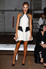 Laura Dundovic paired black pointy pumps with a modern halter dress for the Manning Cartell fashion show.