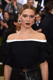 Lea Seydoux teamed her off-the-shoulder gown with a matching leather belt for the 2016 Met Gala.