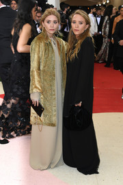 Ashley Olsen channeled her inner diva with this gold evening coat and beige gown combo for the Met Gala.