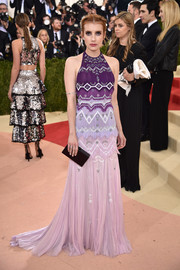 Emma Roberts gave us hippie vibes with this Tory Burch geometric-patterned plisse halter gown in various shades of purple.