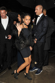 Zoe Kravitz layered a black feather jacket over an LBD for a Met Gala after-party.