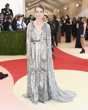 Mackenzie Davis went for all-out shimmer in a caped silver sequin gown by Altuzarra at the Met Gala.