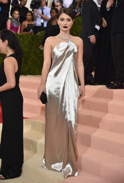Eve Hewson looked simply elegant at the Met Gala in a Monse liquid satin gown with a sculptural neckline.
