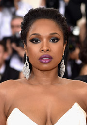 Jennifer Hudson brushed her locks back in a messy-sexy style for the Met Gala.