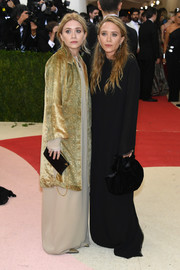 Mary-Kate Olsen arrived for the Met Gala all bundled up in a long-sleeve black maxi dress.