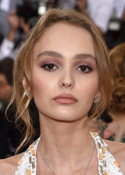 Lily-Rose Depp played up her eyes with a heavy application of dusky-rose shadow.