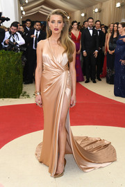 Amber Heard was an Old Hollywood beauty in a champagne silk wrap gown by Ralph Lauren at the Met Gala.