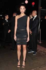 Taylor Hill flashed her undies in a one-shoulder LBD with see-through panels while attending a Met Gala after-party.