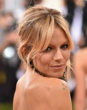 Sienna Miller worked a messy-sexy updo at the Met Gala.