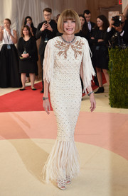 Anna Wintour opted for a Chanel Haute Couture fringed mermaid gown with an embellished yoke for her Met Gala look.