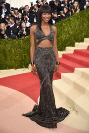 Naomi Campbell sizzled in a sexy gray cutout gown by Cavalli Couture at the Met Gala.