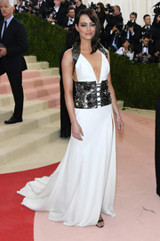 Emma Stone channeled her inner Khaleesi in a deep-V white Prada gown with black harness detailing for her Met Gala look.
