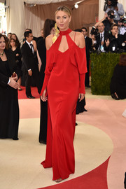Maria Sharapova channeled her inner diva in a red-hot cold-shoulder gown by Juan Carlos Obando for the Met Gala.