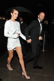 Rosie Huntington-Whiteley polished off her look with strappy silver heels by Gianvito Rossi.