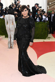 Kris Jenner chose a long-sleeve beaded and sequined gown by Balmain for her Met Gala look.
