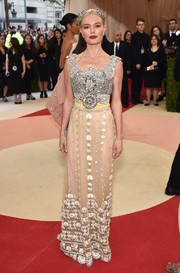 Kate Bosworth looked opulent at the Met Gala in a Dolce & Gabbana gown boasting a heavily beaded bodice and an embroidered skirt.