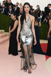 Liu Wen channeled her inner pop star in a metallic net dress by Iris van Herpen for the Met Gala.