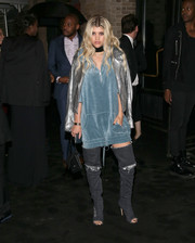 Sofia Richie layered a silver biker jacket over her dress for added edge.