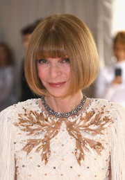 Anna Wintour styled her look with a floral diamond necklace.
