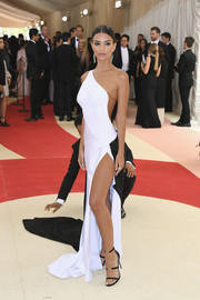 Emily Ratajkowski paired strappy black Tamara Mellon sandals with a monochrome one-shoulder gown for her Met Gala look.