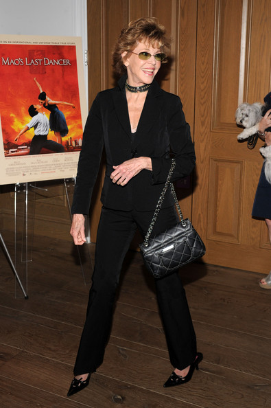 Jane Fonda paired her suit with a quilted chain strap shoulder bag.