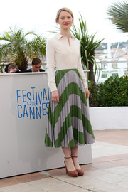 Mia Wasikowska kept the conservative vibe going with a pair of brown platform pumps by Valentino.