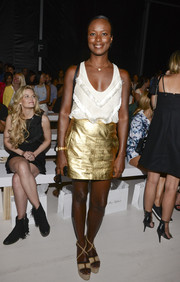 Shala Monroque amped up the flirty feel with a gold leather mini.