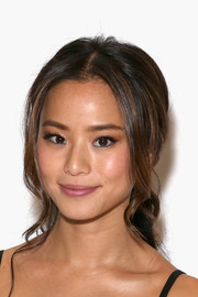 Jamie Chung swept her back into a super-sweet loose ponytail for the Mara Hoffman fashion show.