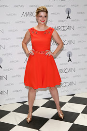 Mischa Barton chose a vibrant orange A-line dress with an embellished neckline and waist.