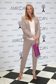 Tatjana Patitz chose a nude pantsuit that featured a fitted blazer and tapered slacks for her look at the Marc Cain photo call.