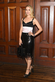 Dianna Agron paired her dress with chunky black platforms.