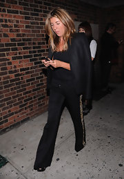 Nina Garcia wore black slacks with beaded trimming at the Marc Jacobs Spring 2013 fashion show.