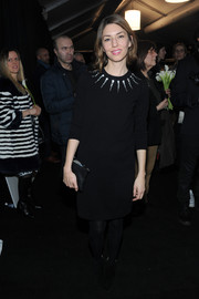 Sofia Coppola looked warm and stylish at the Marc Jacobs fashion show in a black sweater dress with a crystal-embellished neckline.