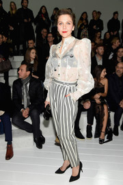Maggie Gyllenhaal kept the quirky-chic vibe going with a pair of black-and-white striped pants, also by Marc Jacobs.