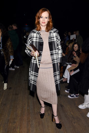 Karen Elson arrived for the Marc Jacobs fashion show wearing a black-and-white plaid coat over a knit outfit.