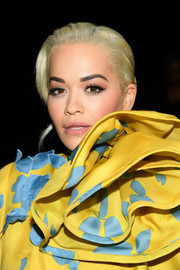 Rita Ora styled her hair into a side-parted bun for the Marc Jacobs Fall 2019 show.