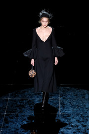 Gigi Hadid walked the Marc Jacobs runway rocking a low-cut LBD with ruffle cuffs.