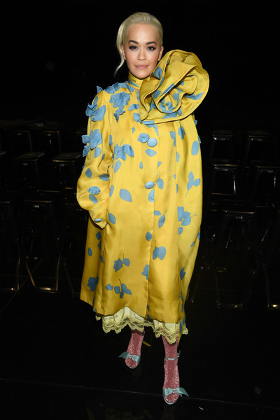 Rita Ora teamed her statement coat with blue bow sandals and shimmering pink tights.